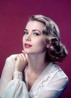 American actress Grace Kelly (1929 - 1982) in a lace-trimmed top