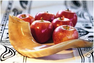 Shofar horn for Rosh Hashanah near apples