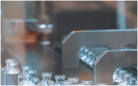Glass bottles in production in the tray of an automatic liquid dispenser, a line for filling medicines against bacteria and viruses, antibiotics and vaccines